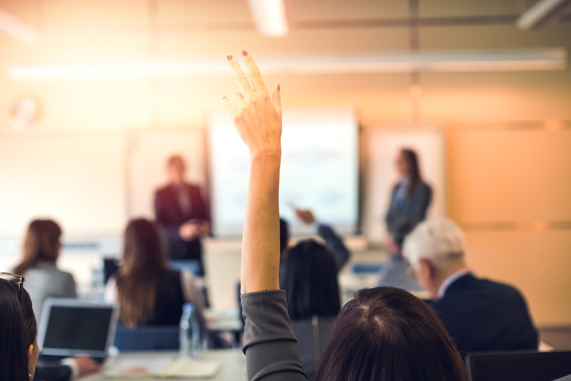 Raised hand, business seminar, education.